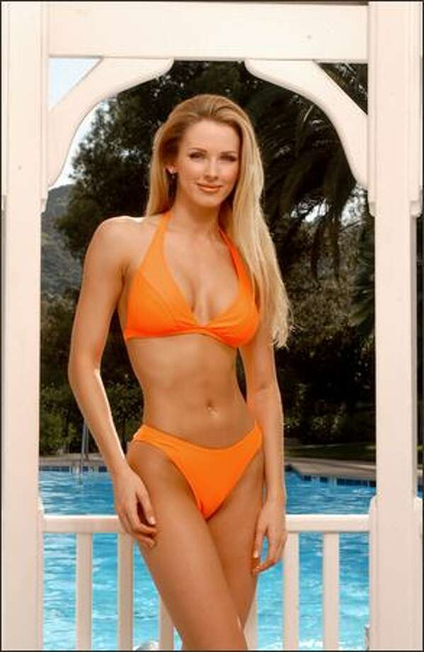 Shandi Finnessey, Miss Missouri USA 2004, poses in her Endless Sun swimsuit during registration and fittings for the Miss USA 2004 competition at the Universal Hilton Hotel in Los Angeles on March 30. Photo: Miss Universe L.P., LLLP