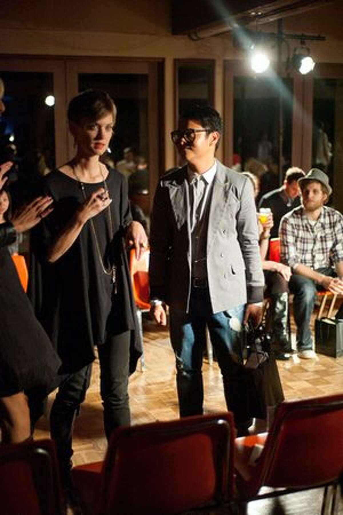 Guests at Blackbird's Autumn/Winter Runway Presentation talk and laugh as they wait for the show to begin.