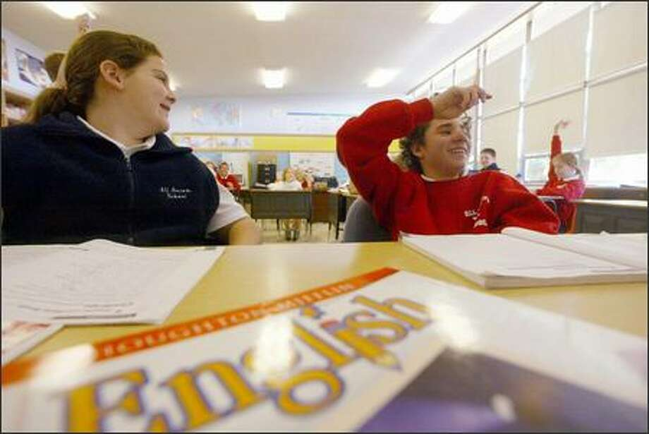 Ali Ronnfeldt and Anthony Duncan during 6th grade class at All Saints Catholic school in Puyallup. Photo: Phil H. Webber, Seattle Post-Intelligencer
