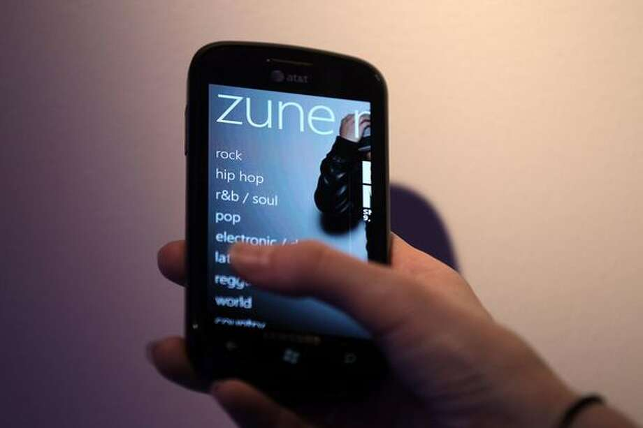 Windows Phone 7 features Zune as its music player. Zune actually will continue for Windows 7 and Windows Phone 7, engadget reported Monday. This means Zune's true end will come as users upgrade to Windows 8 or replace Windows 7 devices. Photo: Getty Images