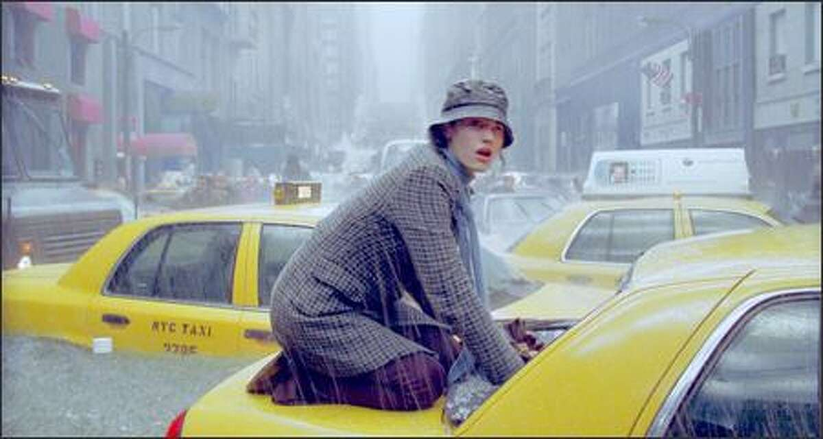 Seconds before Fifth Avenue is buried underwater, Emmy Rossum comes to the aid of a trapped taxi passenger.