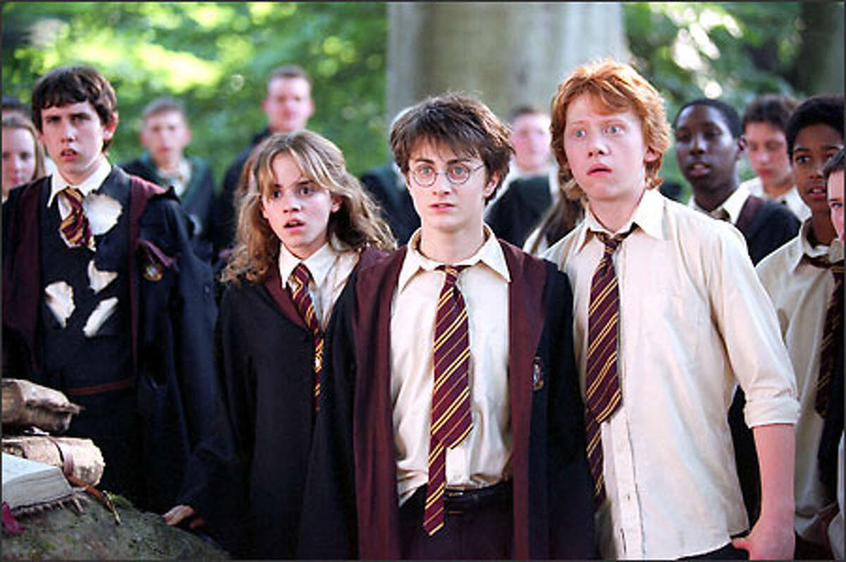 Harry (Daniel Radcliffe, center), Hermione (Emma Watson) and Ron (Rupert Grint) face new surprises as their third year at Hogwarts School of Witchcraft and Wizardry begins.