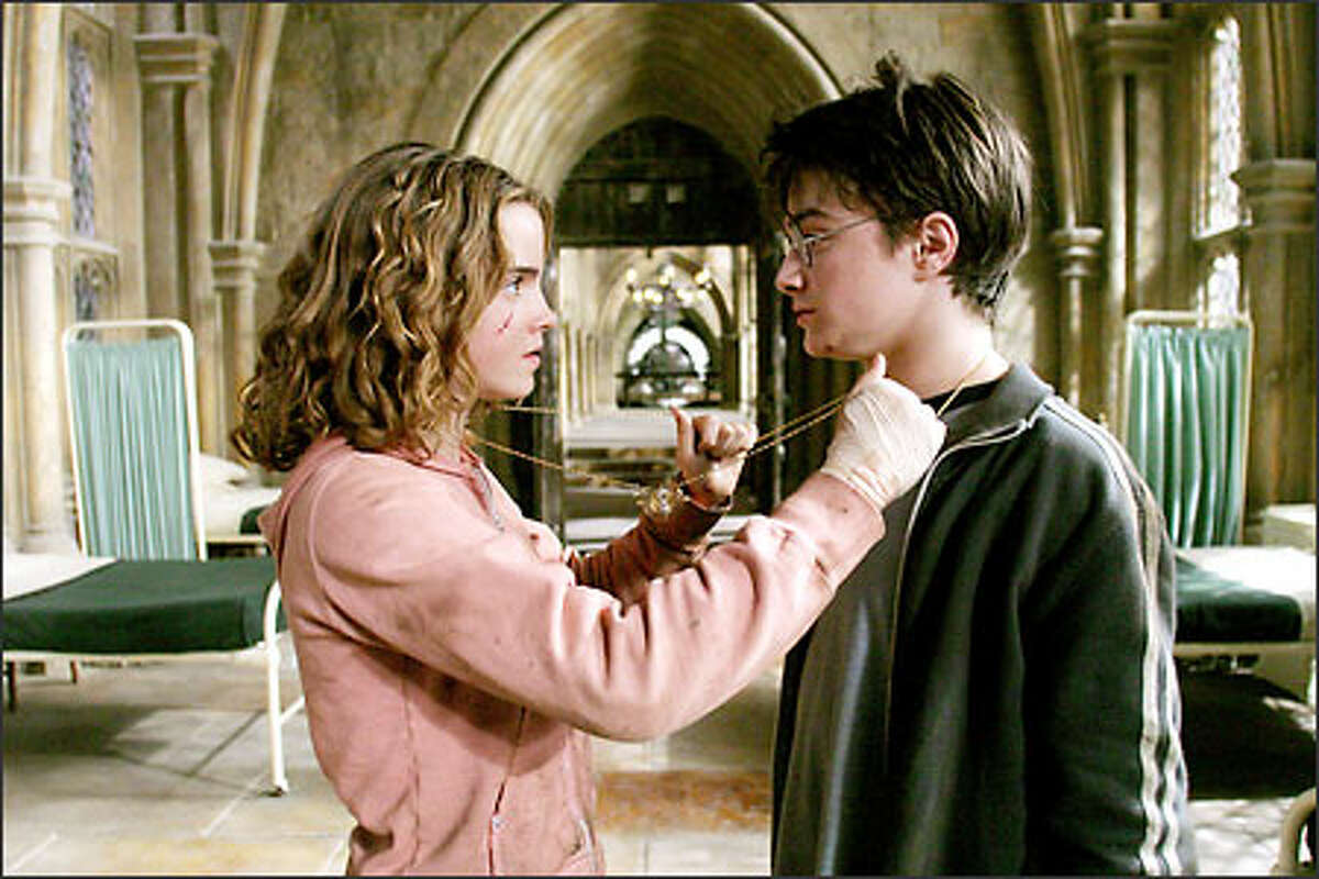 Hermione (Emma Watson) and Harry (Daniel Radcliffe) prepare to travel through time in a bid to save Buckbeak the hippogriff.