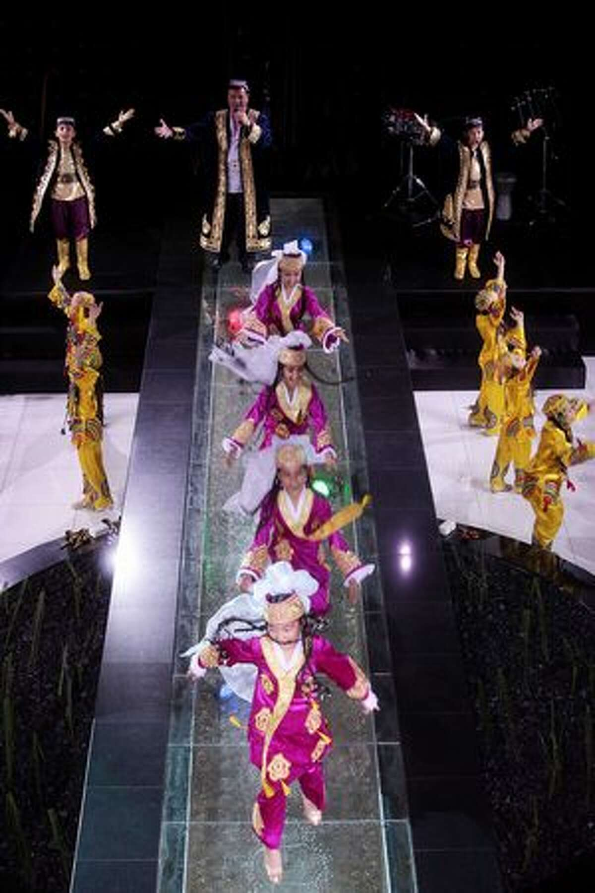 Dancers perform on stage during the Festival Of National Dress at Centre Of National Arts in Tashkent, Uzbekistan.