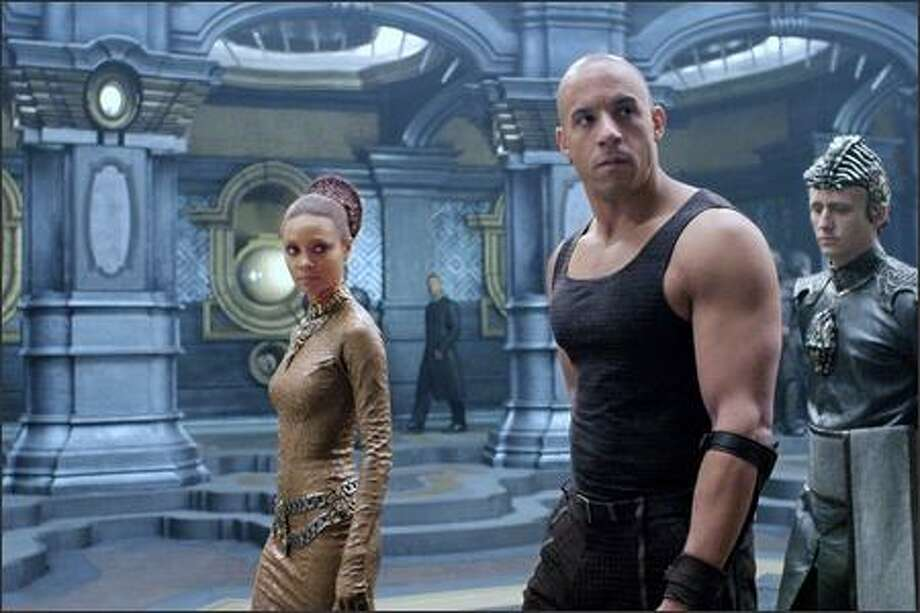 Dame Vaako (Thandie Newton), Riddick (Vin Diesel) and The Purifier (Linus Roache) aboard the Necromonger command ship. Photo: Universal Studios