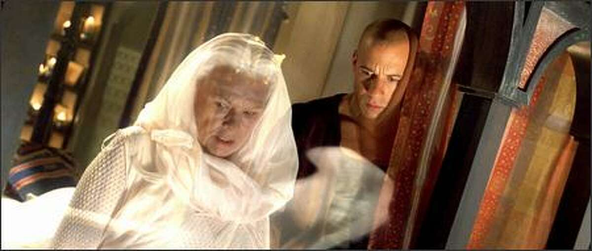 Aereon (Judi Dench), ambassador of the Elementals, helps RIddick (Vin Diesel) unlock the secrets of his past.