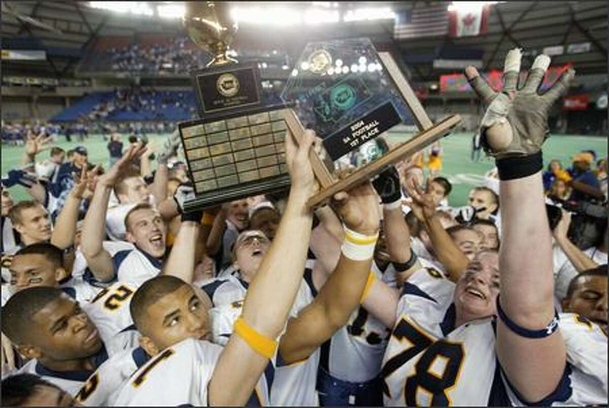 The Bellevue Wolverines celebrate their fantastic fourth state title, a thrilling victory over upset-minded Ferndale in the Tacoma Dome.