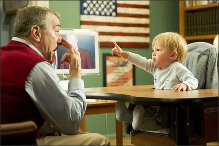 Jack Byrnes (Robert De Niro) plays with his grandson Little Jack. Photo: Universal Studios