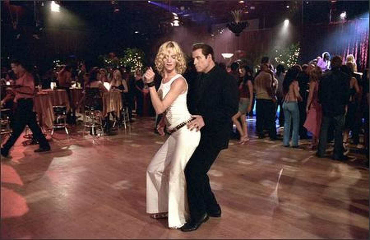 John Travolta and Uma Thurman show their moves on the dance floor in MGM Pictures'