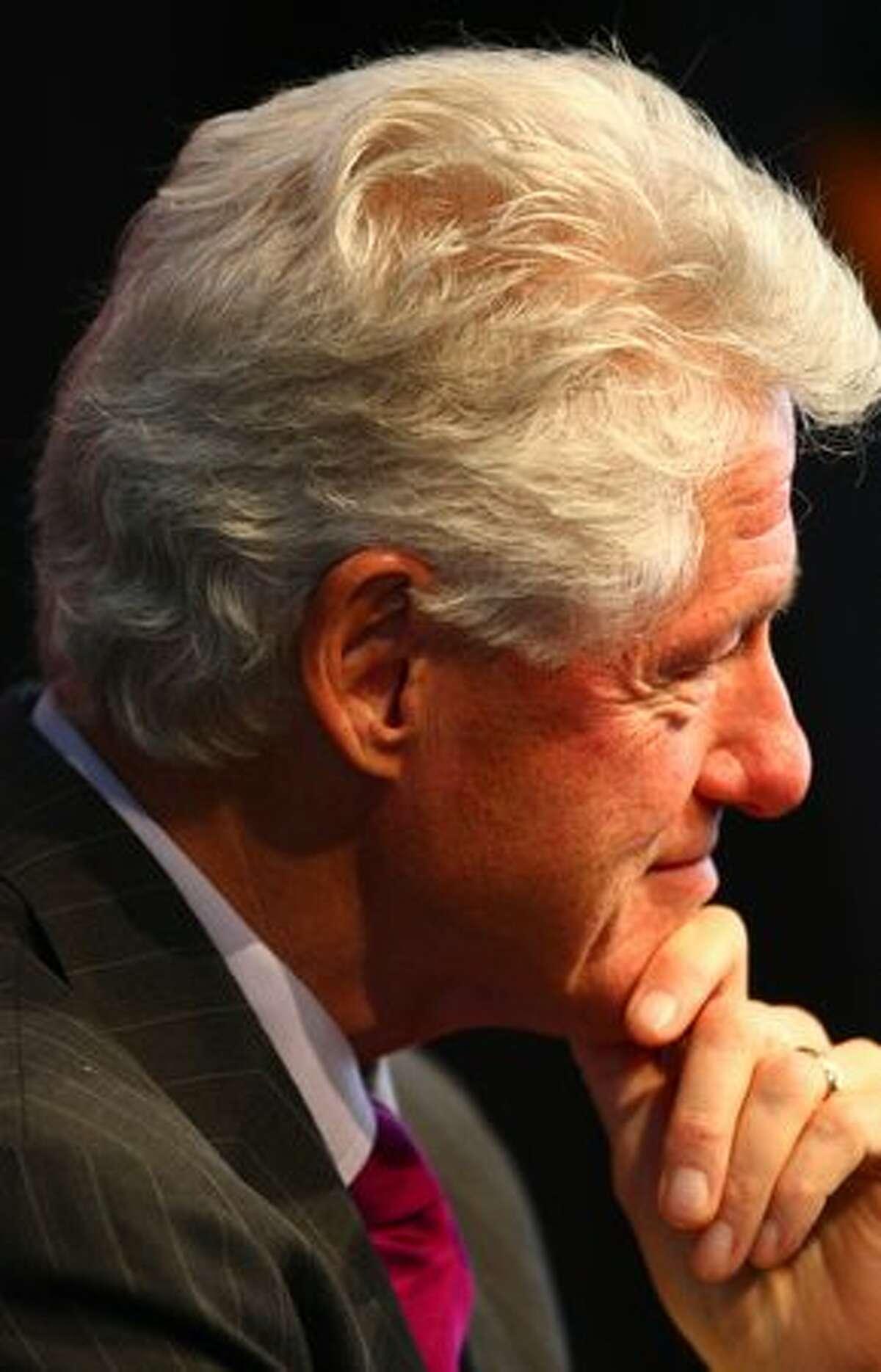 Former U.S. President Bill Clinton waits to take the podium during a campaign event for U.S. Sen. Patty Murray on Monday.