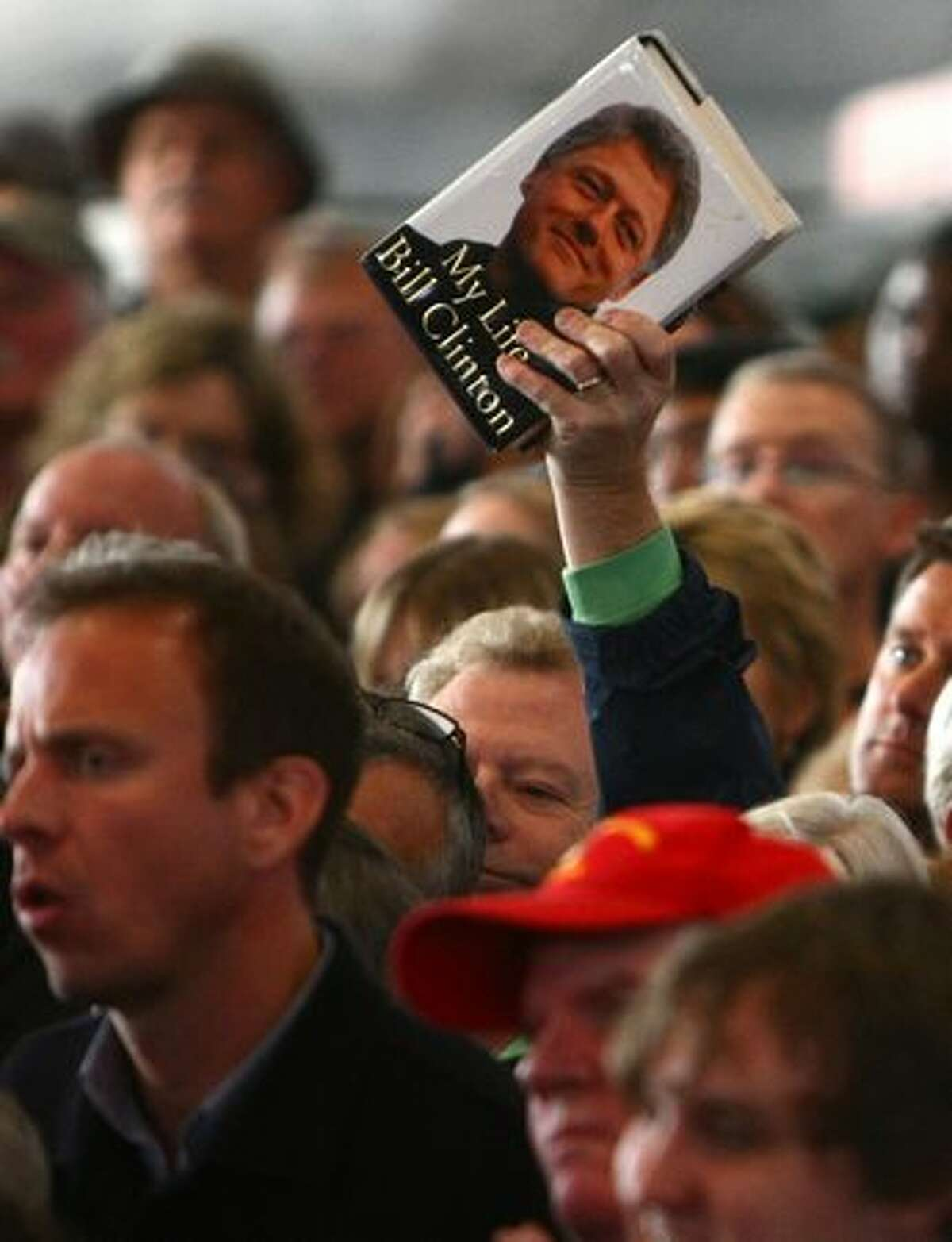 A fan of U.S. President Bill Clinton holds up his book during a campaign event for U.S. Sen. Patty Murray on Monday.