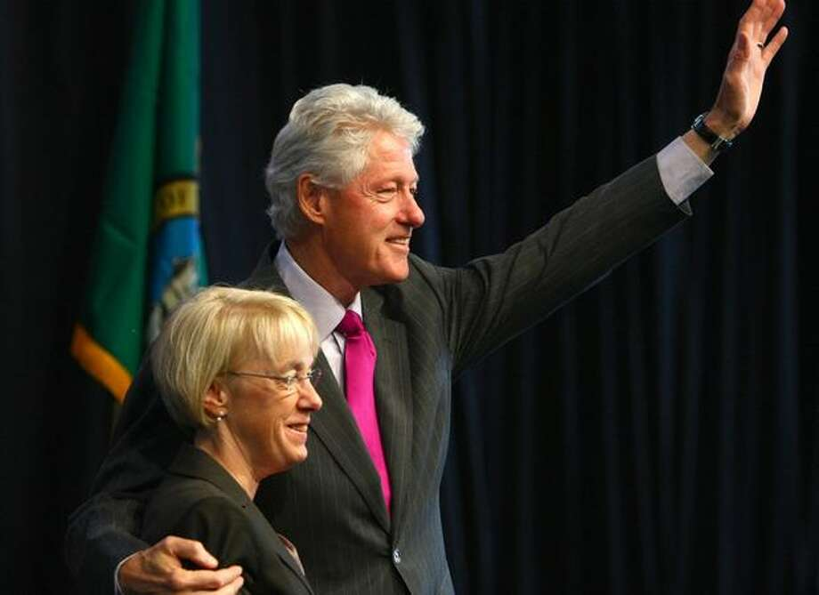 Former U.S. President Bill Clinton embraces U.S. Sen. Patty Murray during a campaign event on Monday at Paine Field's Flying Heritage Collection in Everett. Photo: Joshua Trujillo, Seattlepi.com