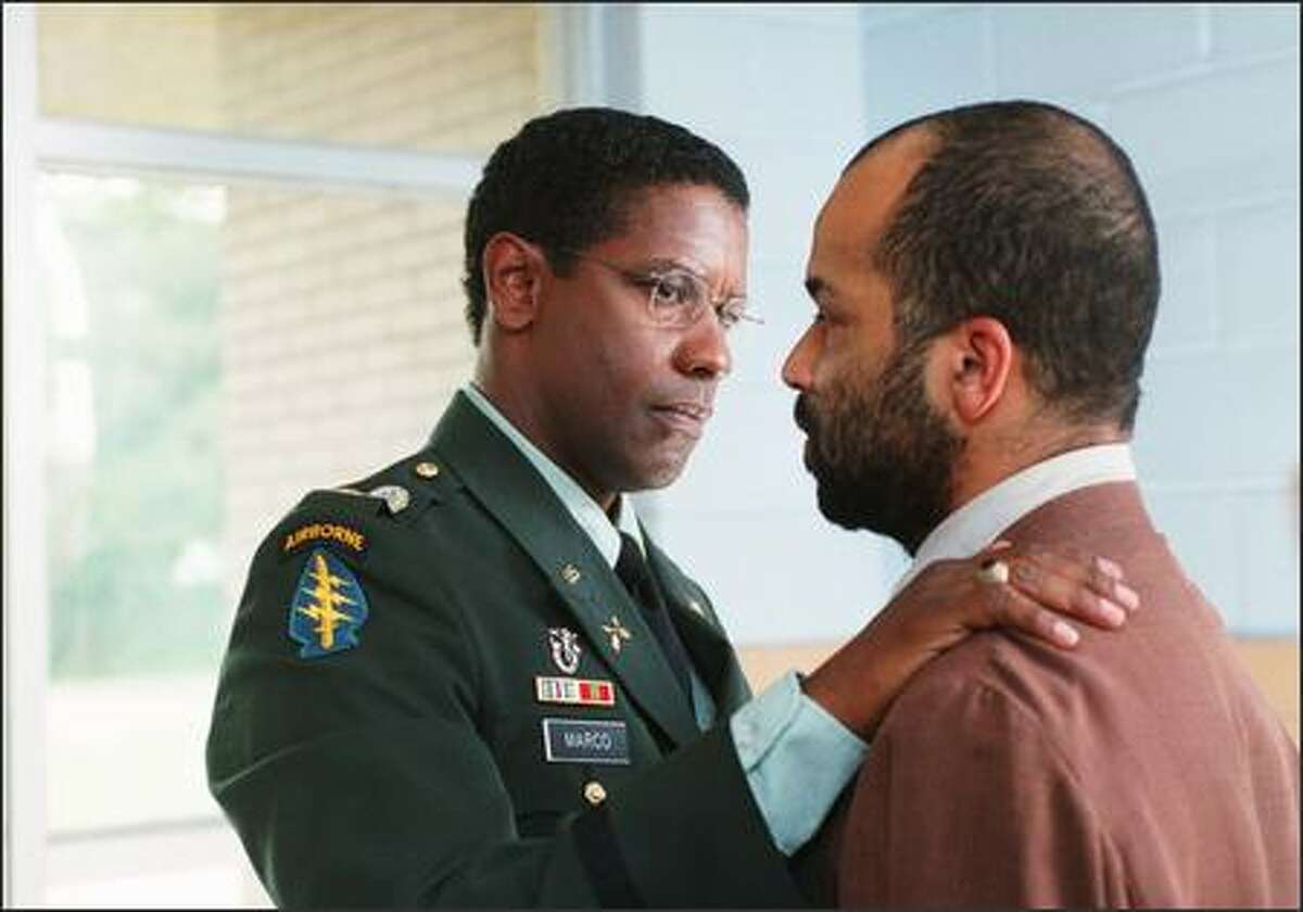 Cpl. Al Melvin (Jeffrey Wright, right) tells his former commander, Major Ben Marco (Denzel Washington), about strange dreams he has experienced about their unit's ambush in Kuwait years earlier -- dreams that call into question official reports and Marco's memories about what happened.