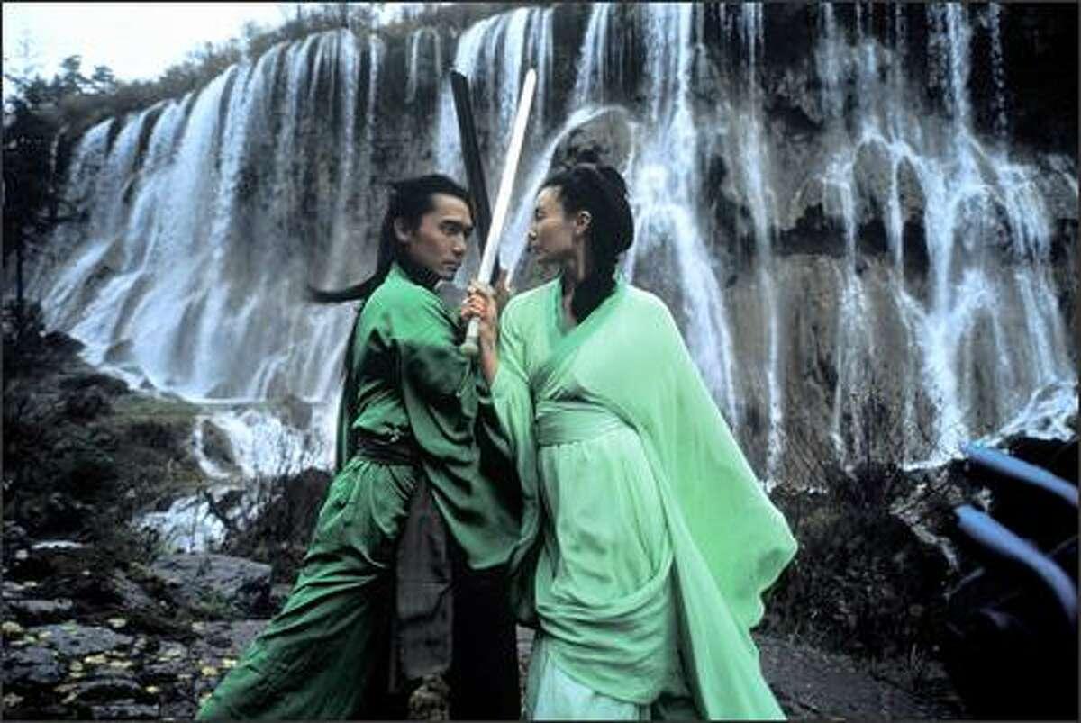 Tony Leung Chiu Wai as Broken Sword and Maggie Cheung Man Yuk as Snow.