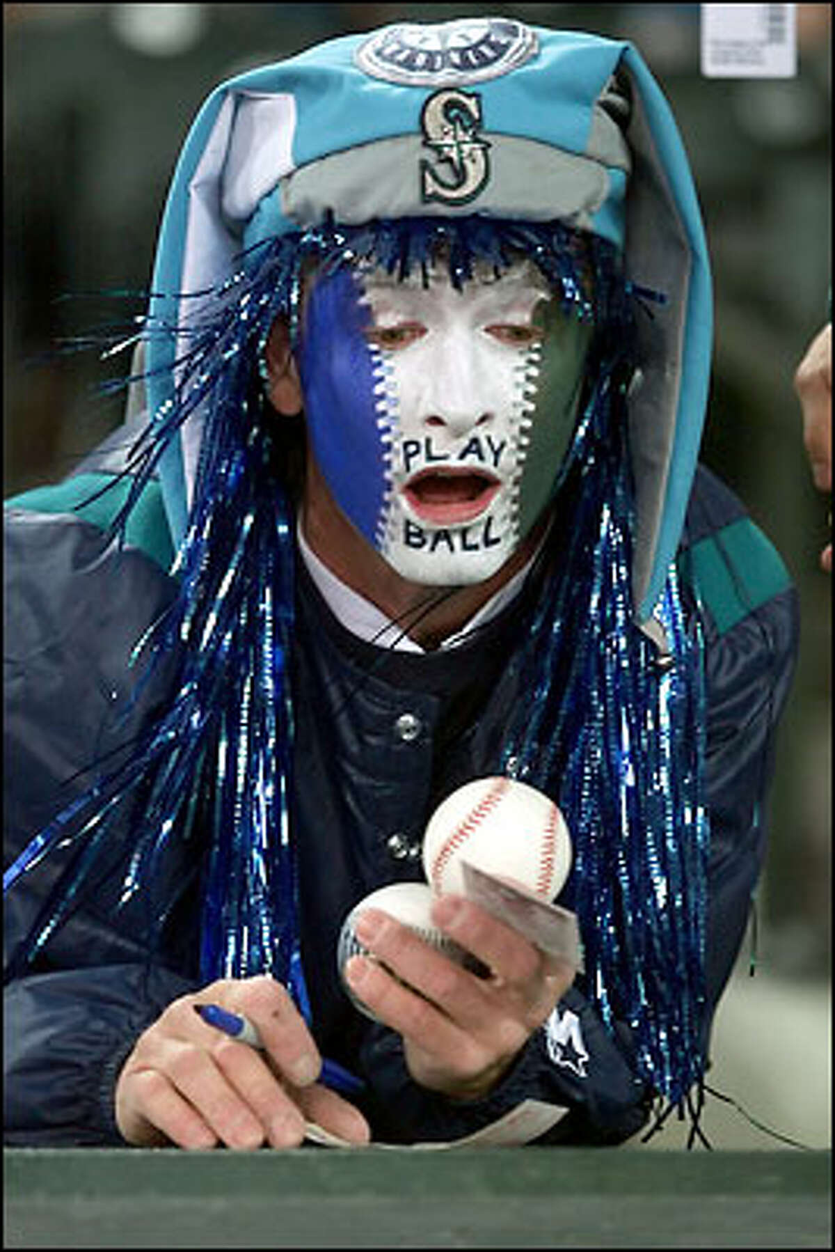 Ron Flanagan of Parkland was ready for the Mariners' season opener against Boston on April 4. Although the Mariners were shut out by Pedro Martinez, 2-0, it marked the only time this season the team had a record under .500.