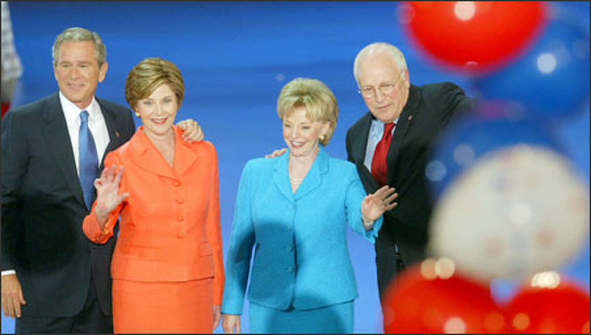 President and Laura Bush and Vice President Dick Cheney and his wife, Lynne, gather after Bush accepted the Republican presidential nomination.