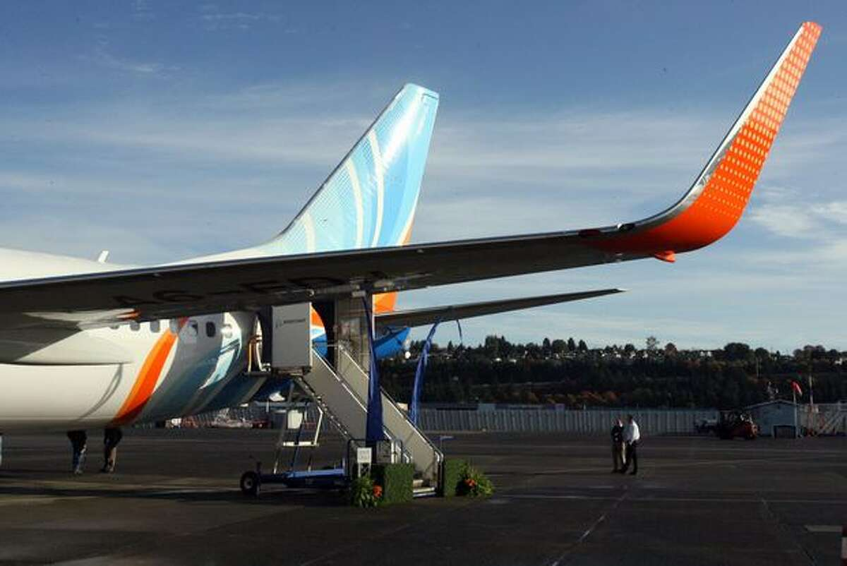 Low-cost airline flydubai's new Boeing 737-800, the first with a Boeing Sky Interior, sits at Boeing Field, in Seattle, before its delivery ceremony.