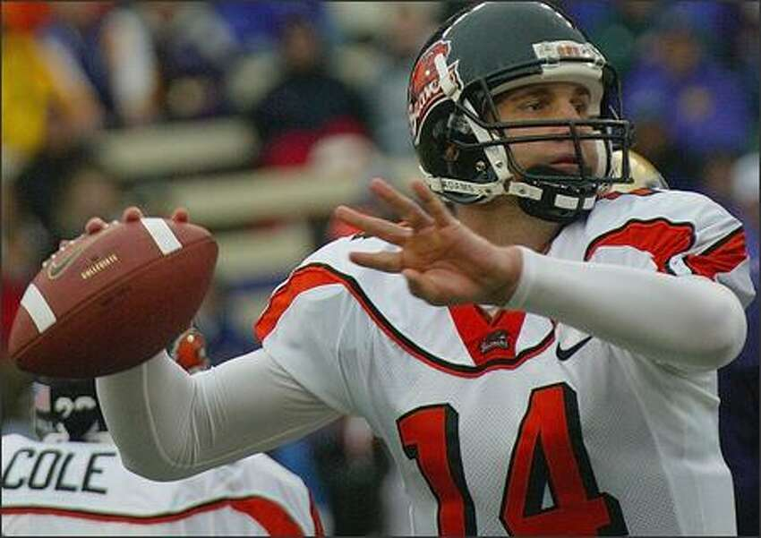 Oregon State University's Derek Anderson (14) at work against the Huskies in the third quarter.