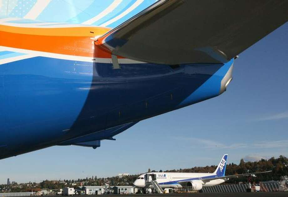 Boeing's second flight-test 787 Dreamliner, ZA002, is seen behind flydubai's new Boeing 737-800, the first with a Boeing Sky Interior, during the 737 delivery ceremony at Boeing Field, in Seattle Photo: Aubrey Cohen, Seattlepi.com