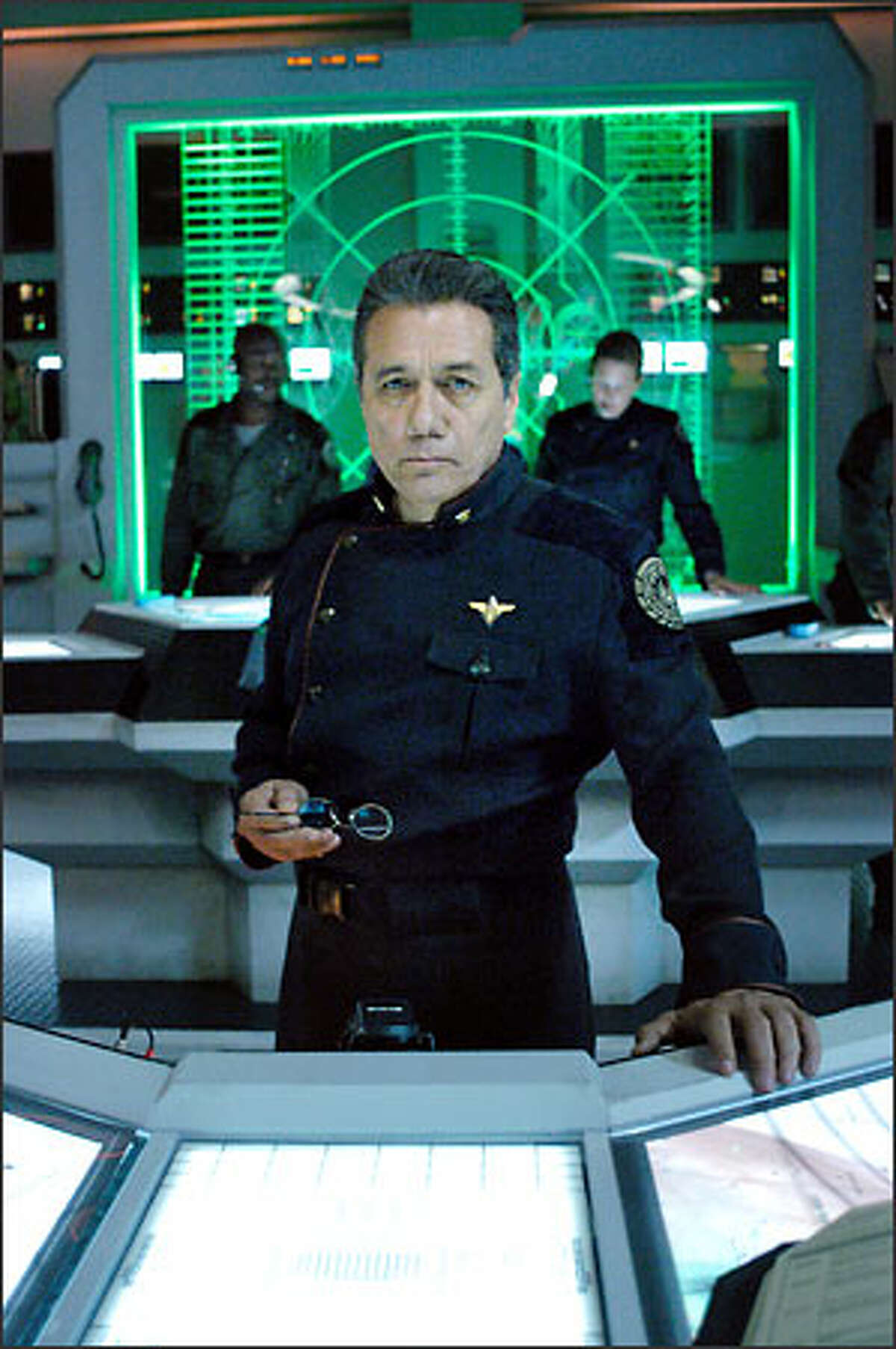 """William Adama (Edward James Olmos), commander of Galactica, the last Colonial battlestar, leads the survivors of the Cylon attack on a quest for the legendary lost human colony called Earth. """"Battlestar Galactica"""" airs on the Sci-Fi Channel Dec. 8-9, 2003."""