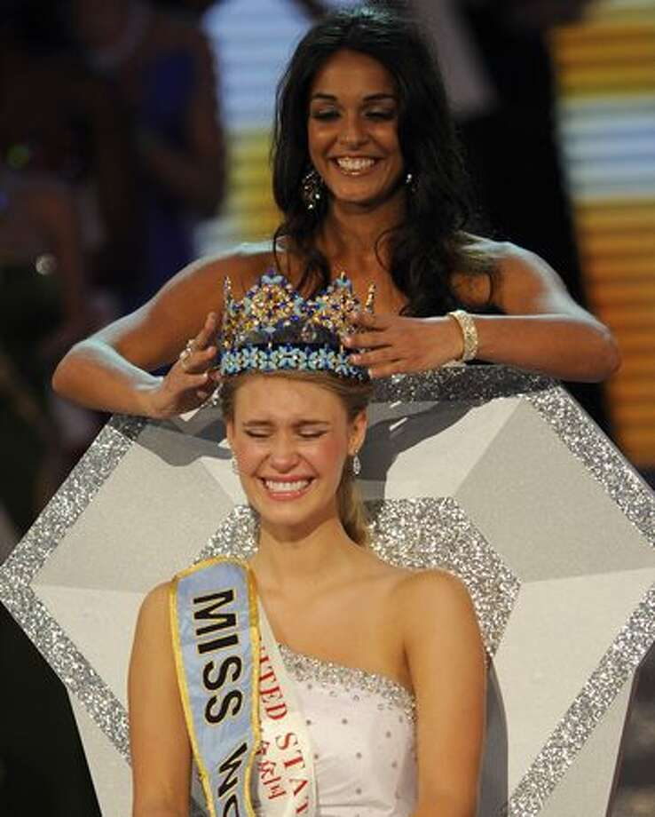 Alexandria Mills (seated) of the United States is crowned as the 2010 Miss World by 2009 Miss World Kaiane Aldorino from Gibraltar during the Miss World 2010 beauty pageant finals at the Beauty Crown Theatre in the southern Chinese resort town of Sanya on Saturday, Oct. 30, 2010. It was only the third win for the U.S. in the 60-year history of the pageant and the first in 20 years. Mills, 18 and a recent high school graduate, is from Louisville, Ky. Photo: Getty Images