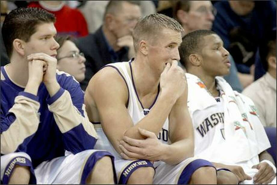 Husky Mike Jensen, center, looks worried as Gonzaga pulls ahead of Washington at the end of the first half. Photo: Meryl Schenker, Seattle Post-Intelligencer