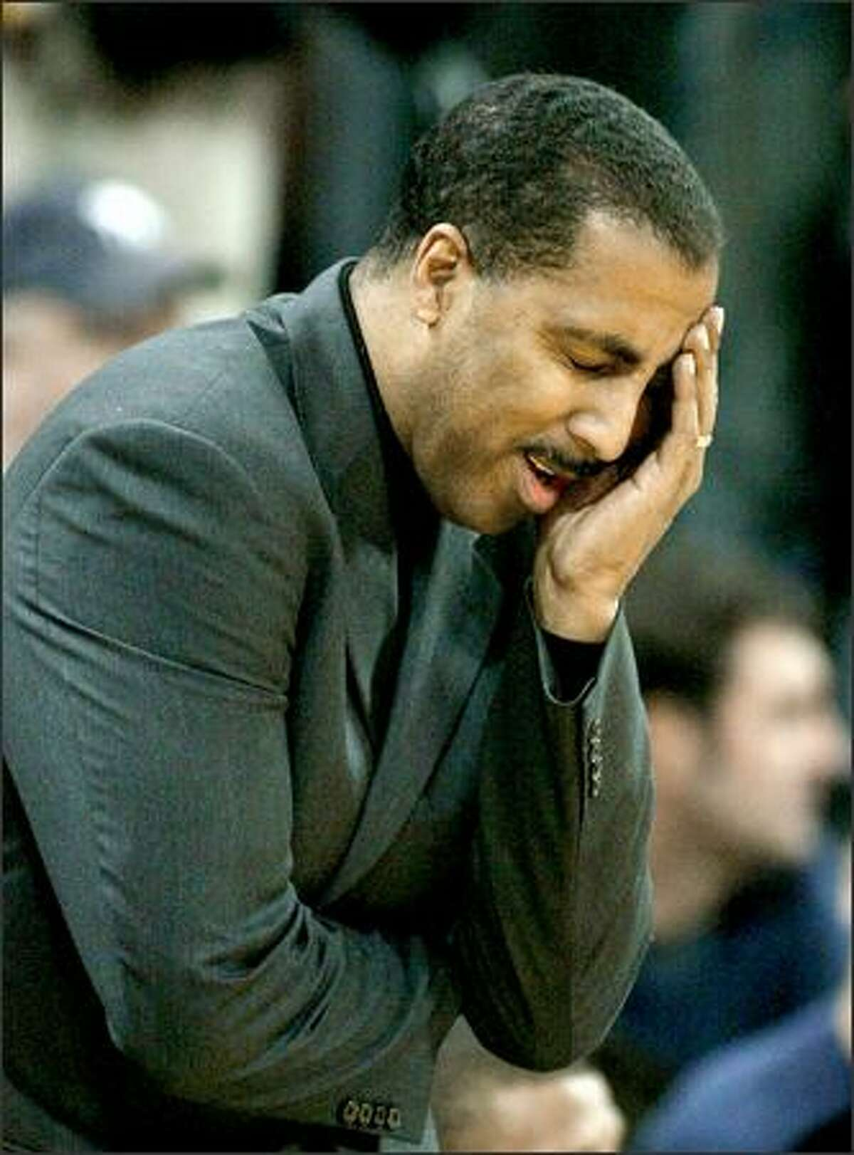 UW Coach Lorenzo Romar reacts to the referee calling a foul on the Huskies in the first half.