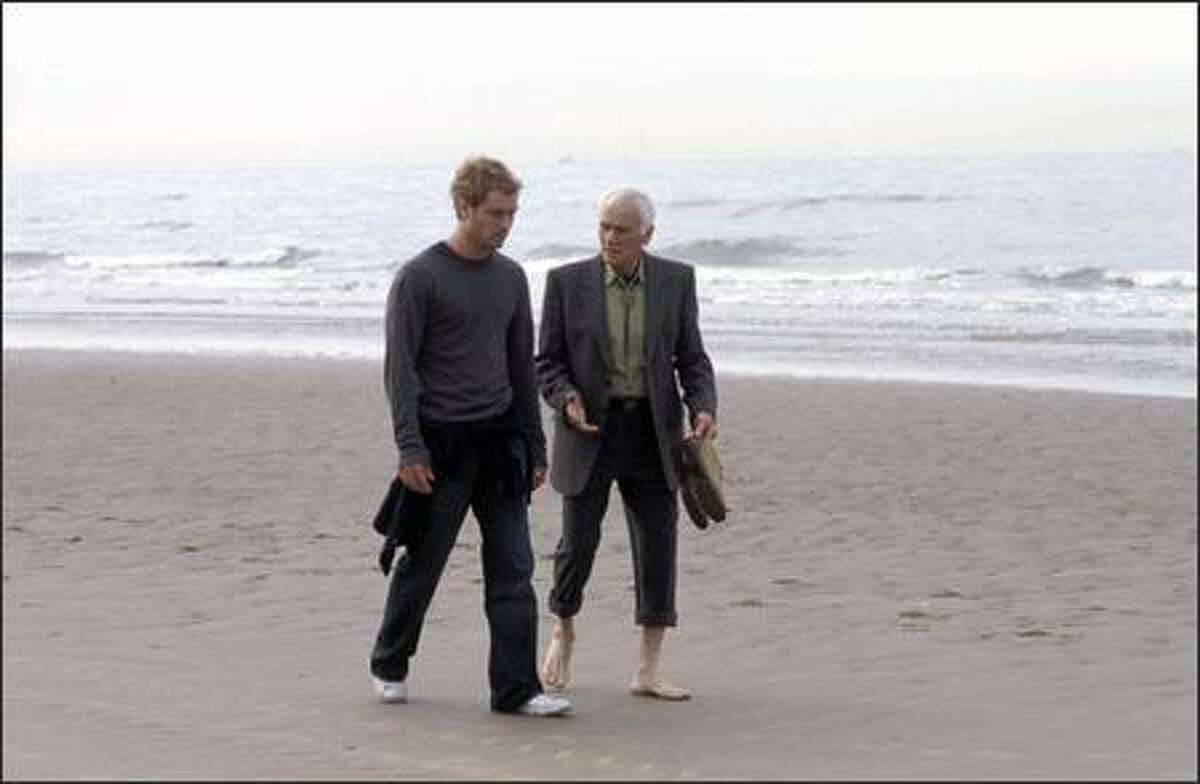 (Left to right) Jude Law as Alfie and Dick Latessa as Joe in