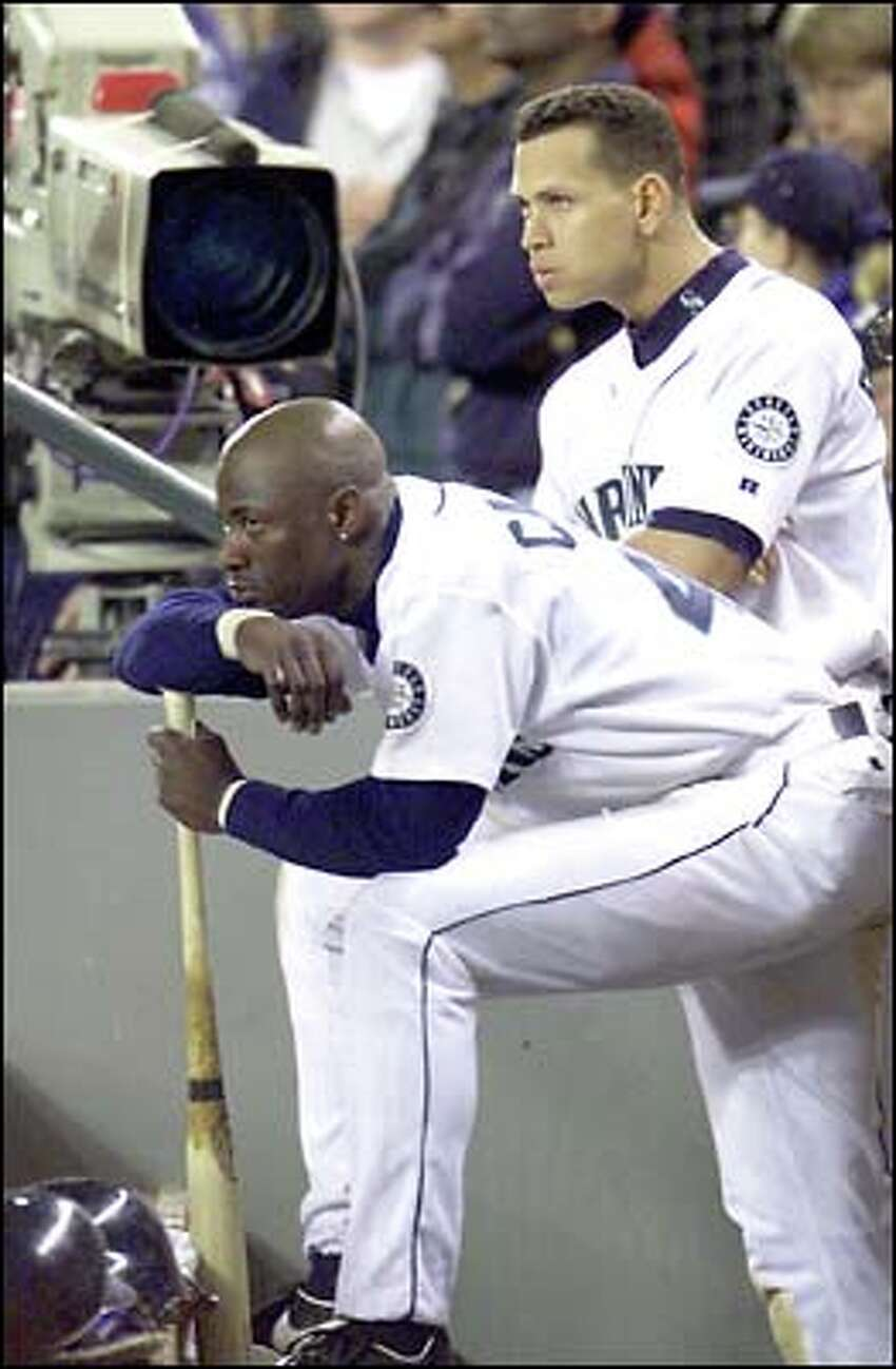 Mike Cameron and Alex Rodriguez are a grim pair as they watch the Mariners' last at-bat in the 8-2 loss to the New York Yankees.