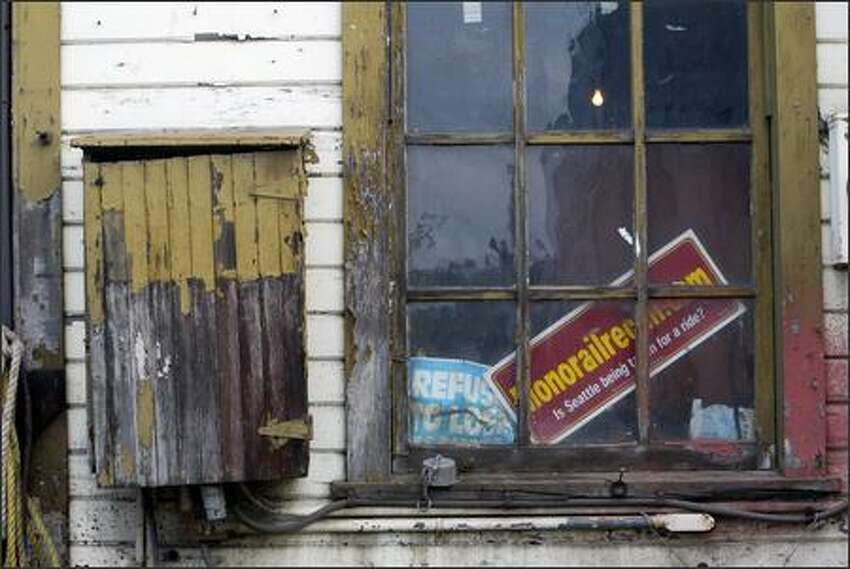 A sign in the oldest building in Fishermen's Terminal on the grounds of Fishing Vessel Owners Marine Ways Inc. shows owner's feelings about the monorail. The shipyard, built in 1919, could face demolition to make way for the monorail's Green Line.