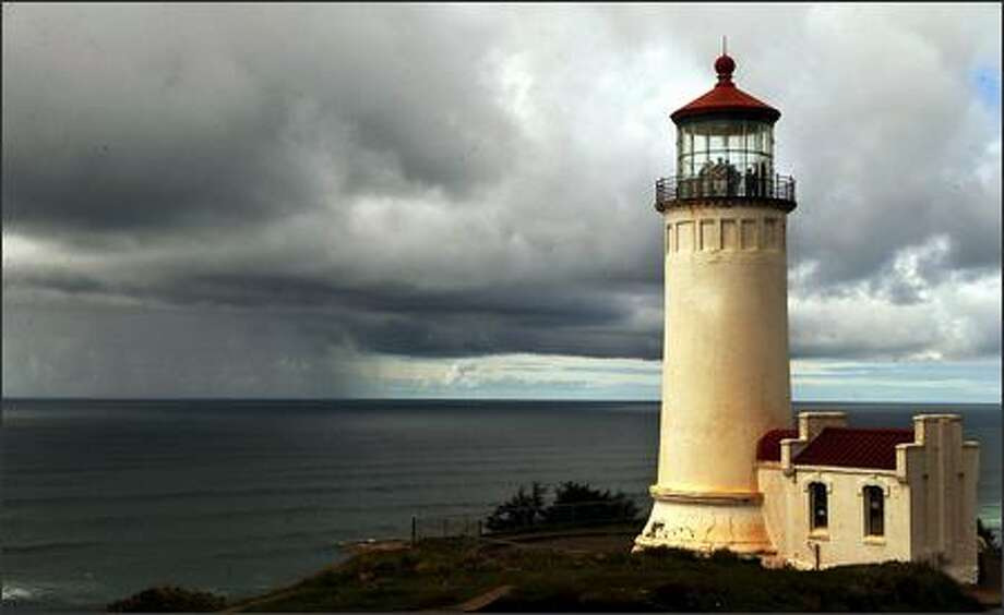 A tour group visits the North Head Lighthouse, which sits serenely in Cape Disappointment State Park near Ilwaco as a Pacific Ocean Storm rages in the distance.A tour group just happened to be huddled in the North Head Light House at Cape Disappointment State Park as a storm raged off the southwest Washington coast. Photo: Jeff Larsen, Seattle Post-Intelligencer
