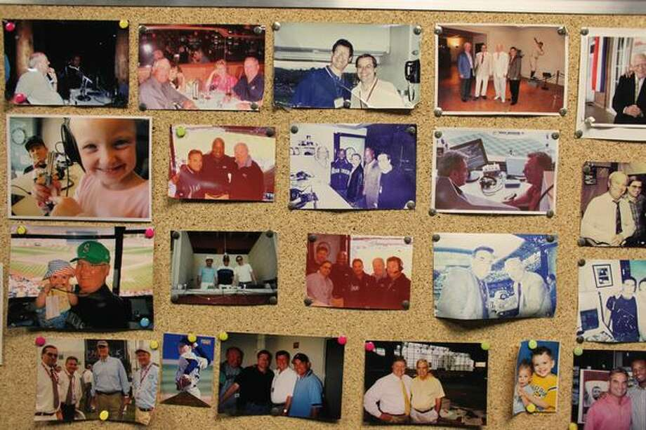 Photos of family and friends are shown inside the booth of Mariners broadcaster Dave Niehaus. Photo: Joshua Trujillo, Seattlepi.com