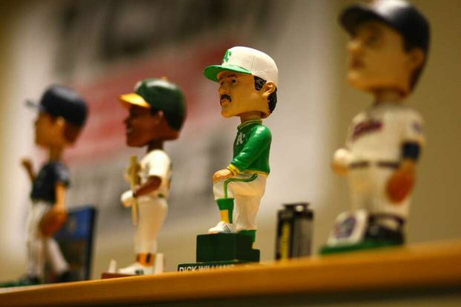 Bobblehead dolls are shown in the booth of Mariners broadcaster Dave Niehaus. Photo: Joshua Trujillo, Seattlepi.com