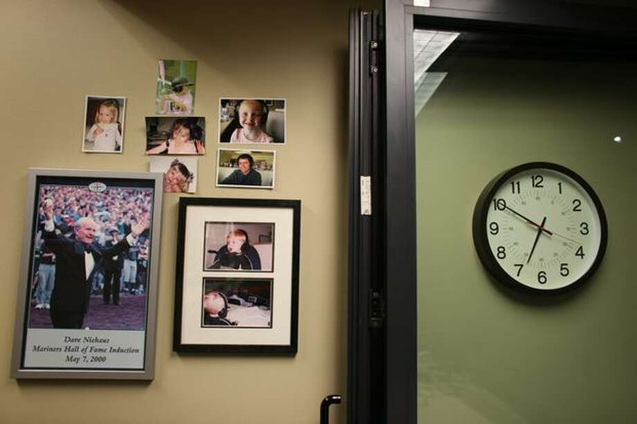 Photos are shown inside the booth of Mariners broadcaster Dave Niehaus. Photo: Joshua Trujillo, Seattlepi.com