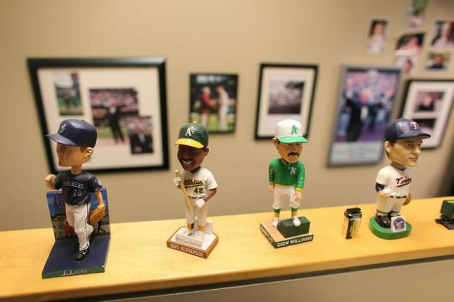 Bobblehead dolls are shown in the broadcast booth of Mariners broadcaster Dave Niehaus. Photo: Joshua Trujillo, Seattlepi.com