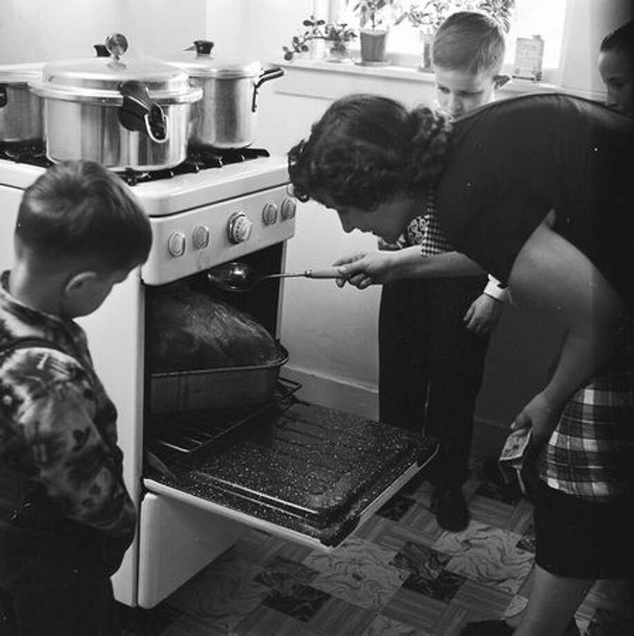 Don't baste the turkey after you've put it in the oven.  Photo: Getty Images