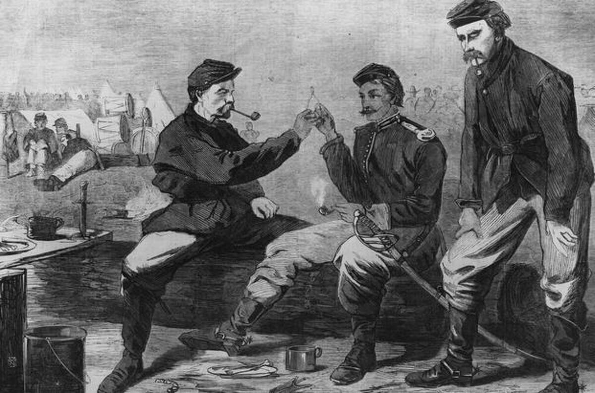 Circa 1862: Two soldiers break a wishbone after a Thanksgiving dinner during the Civil War, both of them hoping for peace, in this artist's rendering.