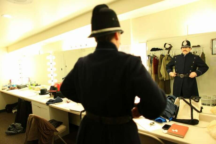 "Eric Riedmann, performing the role of Garrison, puts on his costume during a dress rehearsal for ""Sherlock Holmes and the Case of the Christmas Carol"" at the Taproot Theatre in Seattle's Greenwood neighborhood. Photo: Joshua Trujillo, Seattlepi.com"