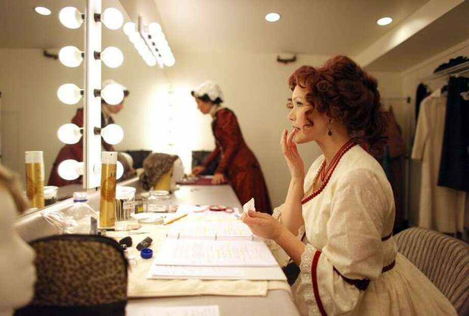 "Jesse Notehelfer prepares for her role as Becky in ""Sherlock Holmes and the Case of the Christmas Carol"" during a dress rehearsal at the Taproot Theatre. Photo: Joshua Trujillo, Seattlepi.com"