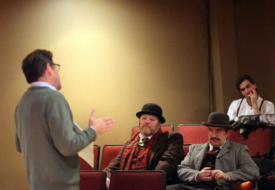 "Director Scott Nolte, left, works with actors during a dress rehearsal for ""Sherlock Holmes and the Case of the Christmas Carol"" at the Taproot Theatre in Seattle's Greenwood neighborhood. The play was originally scheduled in 2009 but an arson fire forced the theater to cancel the show. In 2010 the Taproot is finally able to premiere the play. Photo: Joshua Trujillo, Seattlepi.com"