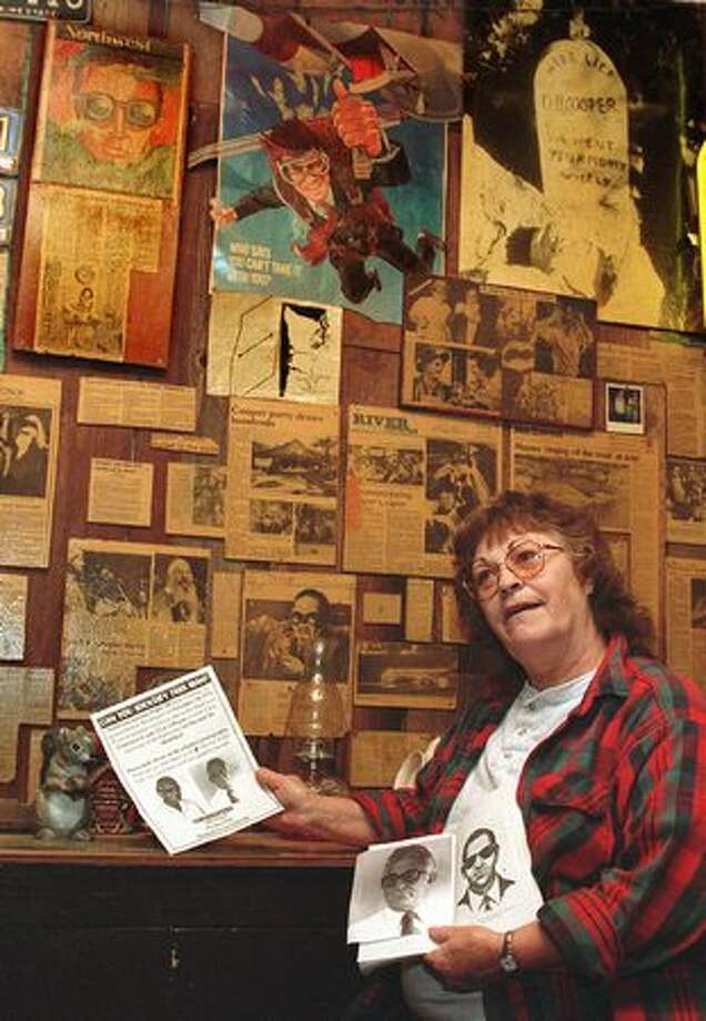 The 1996 photo caption read: Dona Elliott, the current owner of the Ariel Store in Ariel, Wash., poses holding a letter from a woman in Florida saying that her husband confessed on his deathbed in 1995 to being D.B. Cooper. (The Associated Press/provided by seattlepi.com archive) Photo: P-I File