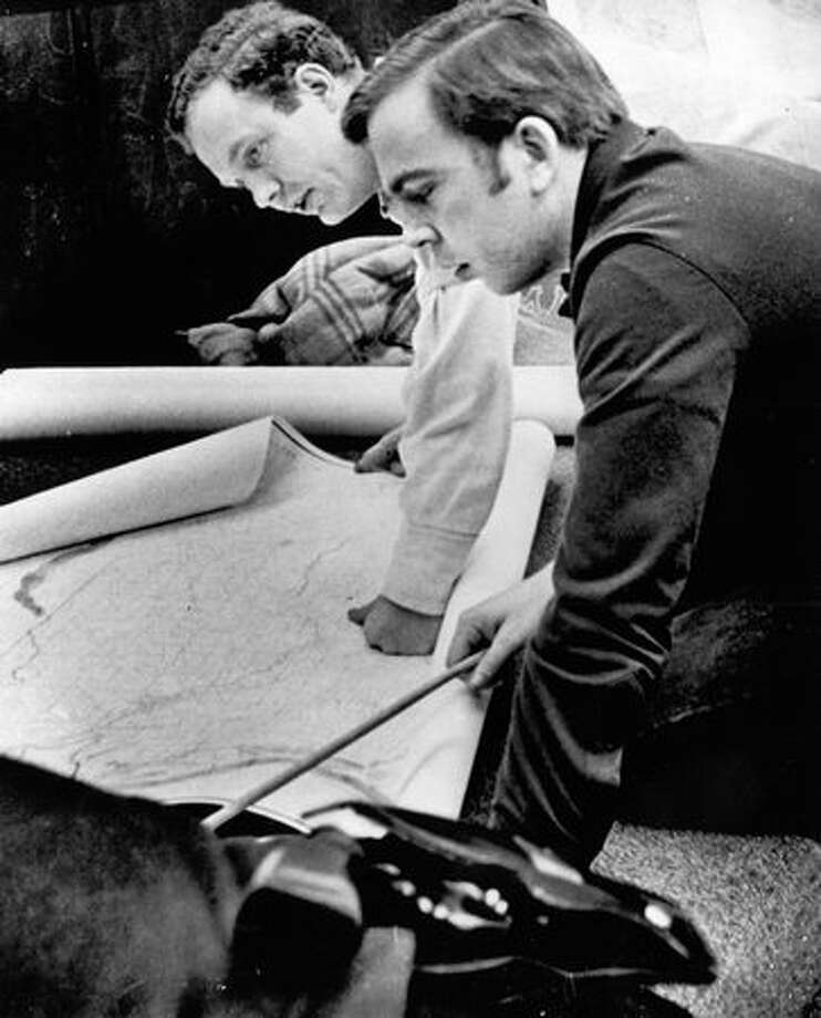 FBI special agents check a map Nov. 26, 1971, at D.B Cooper search headquarters in Clark County, Wash.  (The Associated Press/provided by seattlepi.com file) Photo: P-I File