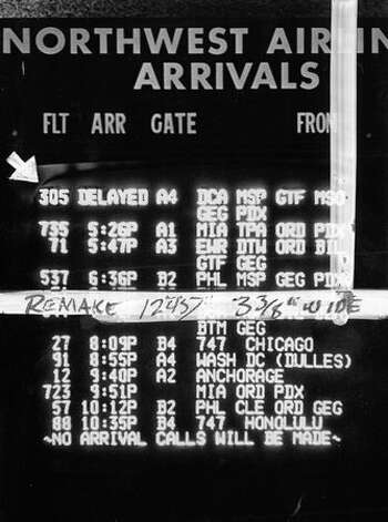 The arrivals signboard at Sea-Tac International Airport on Nov. 24, 1971, the night D.B. Cooper hijacked the flight. (seattlepi.com file/Tom Barlet) Photo: P-I File