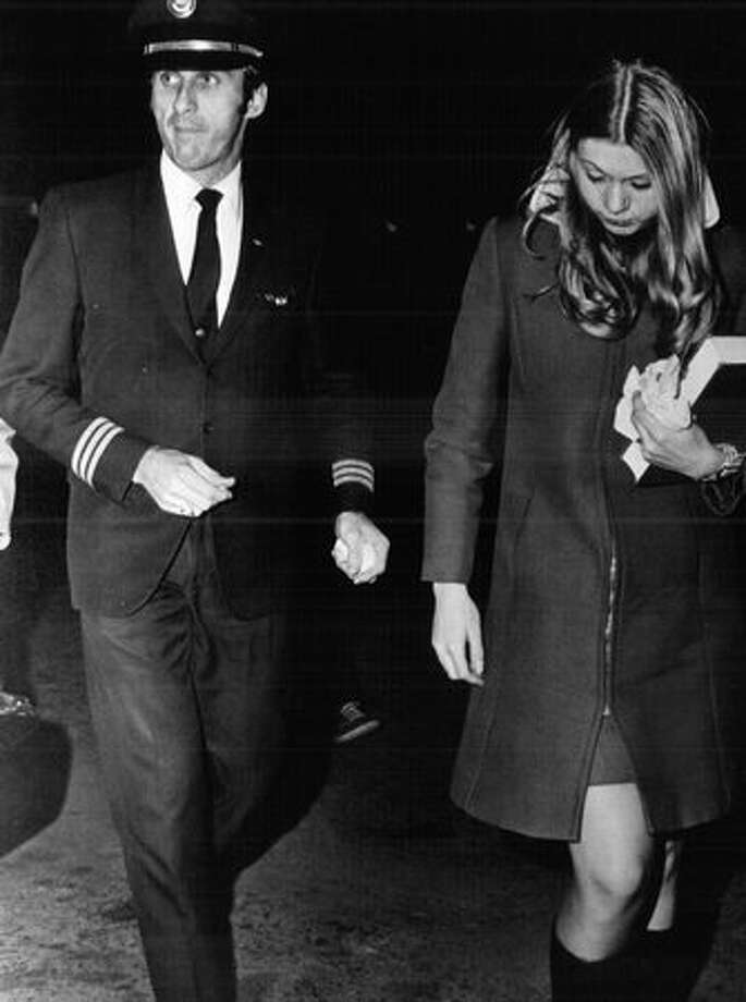 Co-pilot Bill Rataczak and flight attendant Tina Mucklow on Nov, 25, 1971 after their flight was hijacked by D.B. Cooper. (The Associated Press/provided by seattlepi.com file) Photo: P-I File