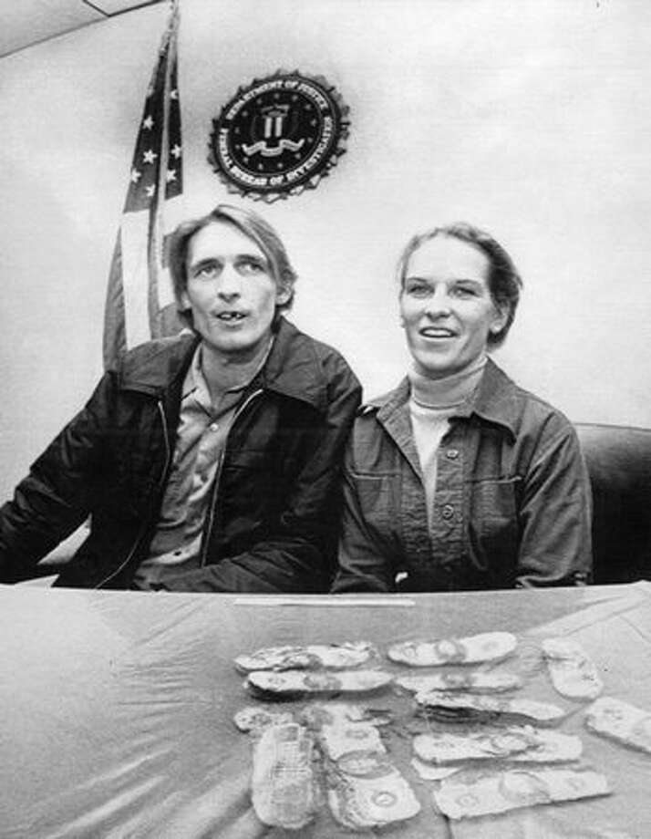 Howard and Patricia Ingram of Vancouver, Wash., sit with several thousand dollars that the FBI said was paid to airplane hijacker D.B. Cooper. Their son, Brian, found some the money in 1980 on a picnic near the Columbia River. (The Associated Press/provided by seattlepi.com file) Photo: P-I File