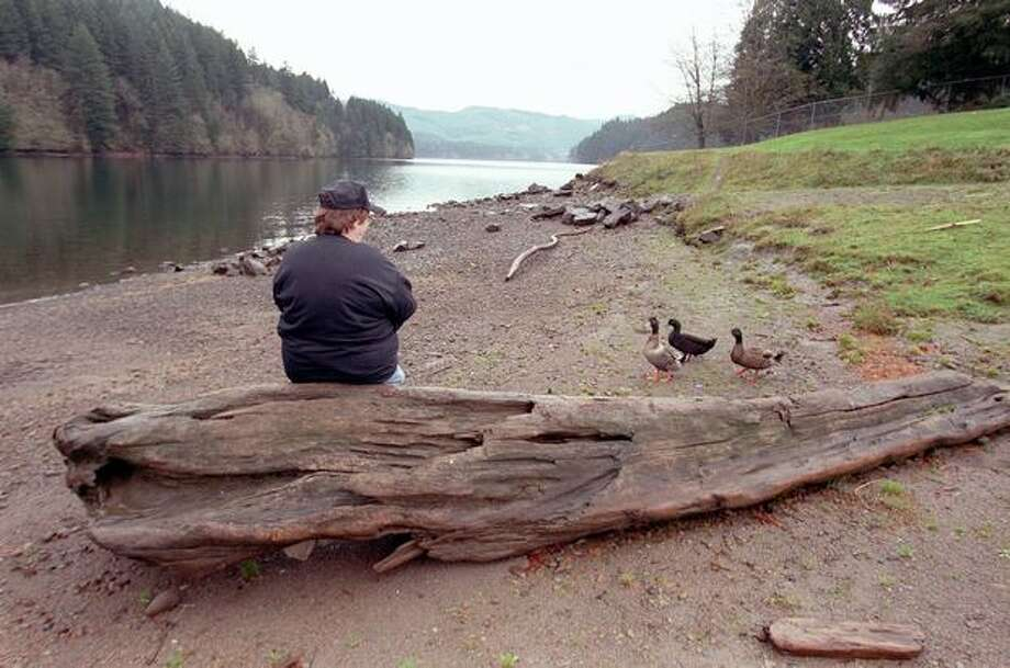 The 2001 photo caption read: Dona Elliott owner of Ariel store take a break at Merwin Lake near her store and tavern. The FBI sent divers to check to see if they could find D. B. Cooper after he hijacked a plane an bailed out in the area. (Phil H. Webber/seattlepi.com file) Photo: P-I File