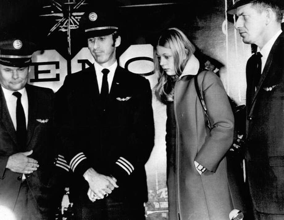 The crew of the Northwest Airlines jet hijacked by D.B. Cooper in November 1971, appearing at a news conference in Reno, Nev. after the plane landed. Cooper parachuted off of the jet with $200,000. Left to right are: Capt. William Scott, First Officer Robert Rataczak, flight attendant Tina Mucklow and Second Officer Harold Anderson. (The Associated Press/provided by seattlepi.com file) Photo: P-I File