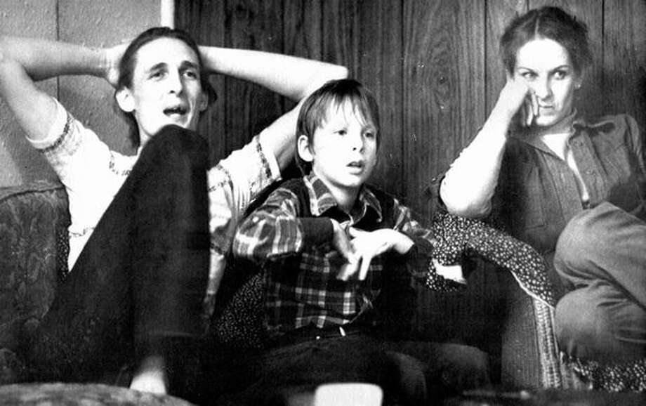 Feb. 13, 1980: Brian Ingram, 8, center, found what thousands of searchers spent nine years looking for: D.B. Cooper's money. Pictured here with his parents H. Dwayne and Patricia Ingram, Brian found the money on a Columbia River beach while clearing a sand pit for a fire. (The Associated Press/provided by seattlepi.com archive) Photo: P-I File
