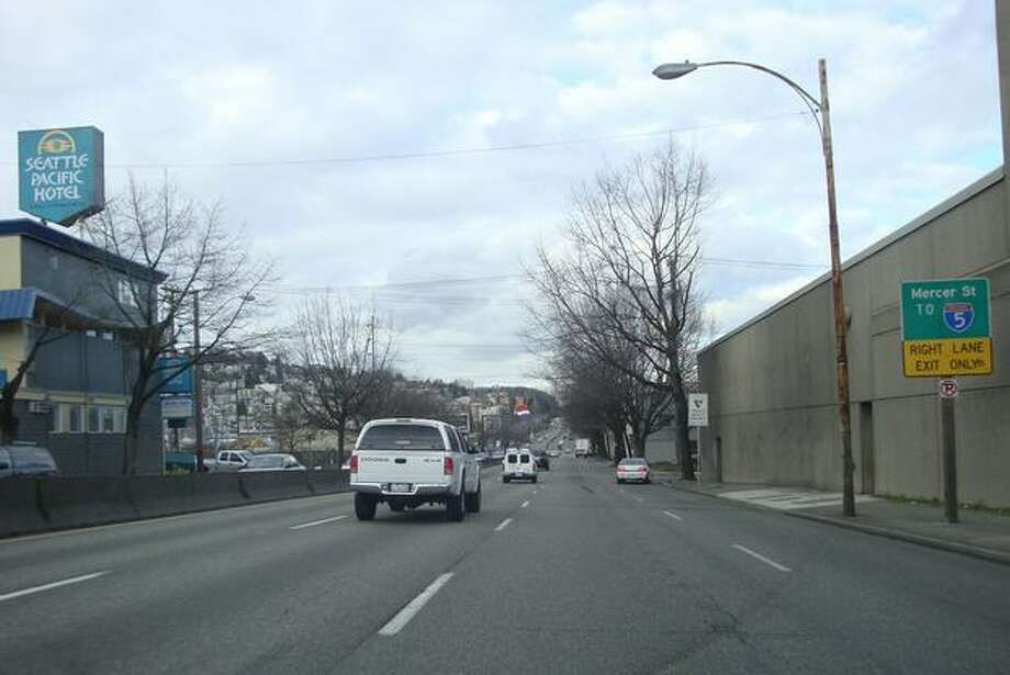 Now: View to the north up Aurora Avenue (Highway 99) from Harrison Street. (Photo provided by WSDOT)