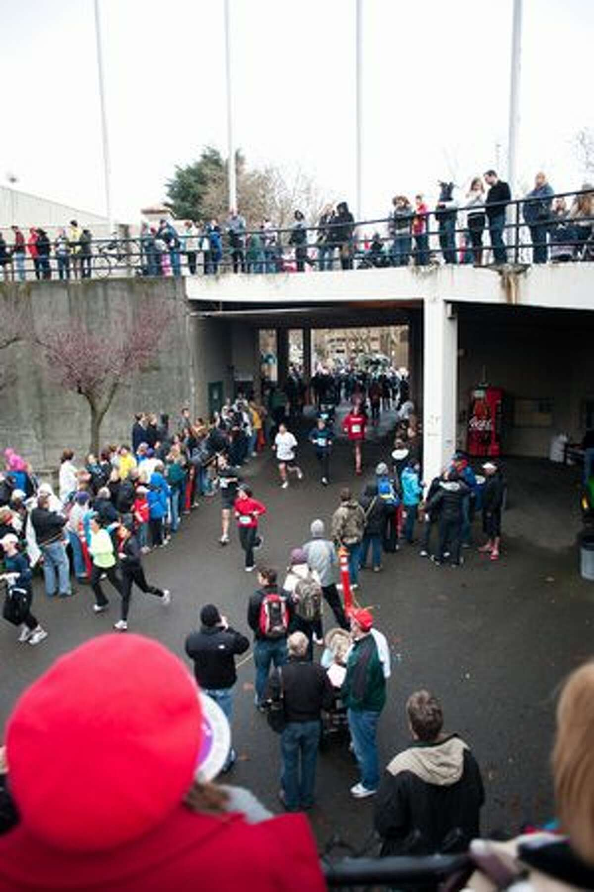 Runners make their way to the finish line at Memorial Stadium.